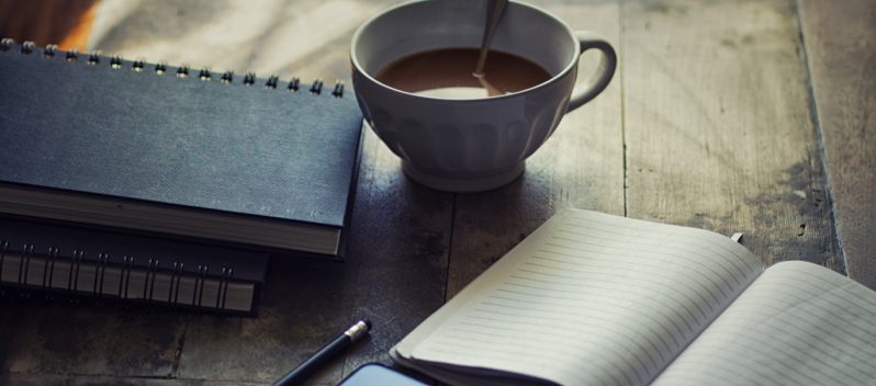 coffee and books on table